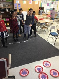 Students playing a game at the Valentine's Day party.