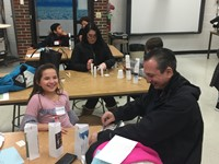 Families doing experiments at STEAM night.