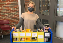 Librarian with book cart.