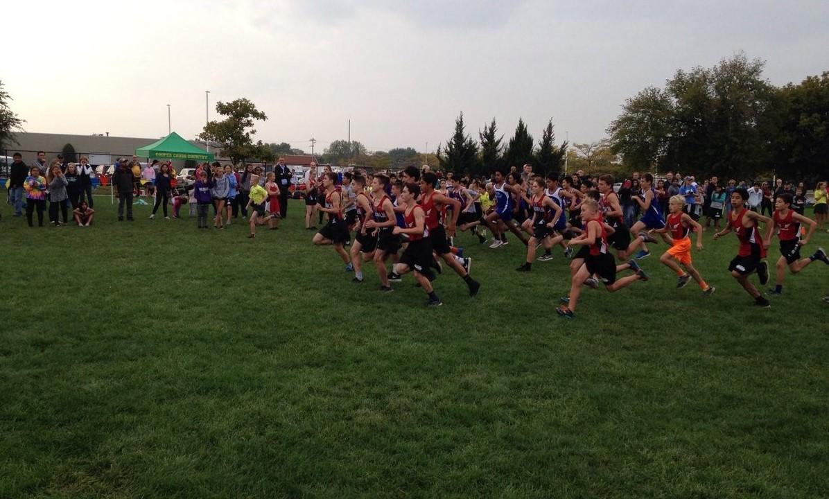 Cross Country Team running across the field