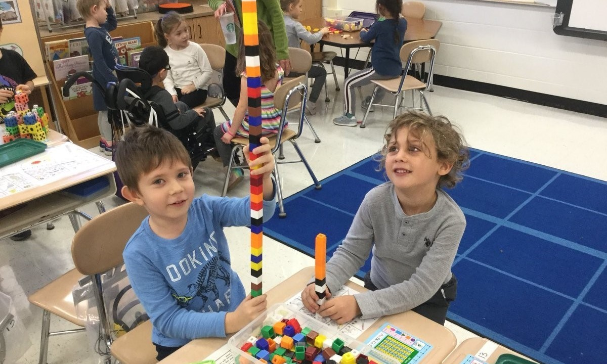 Kids building towers with blocks