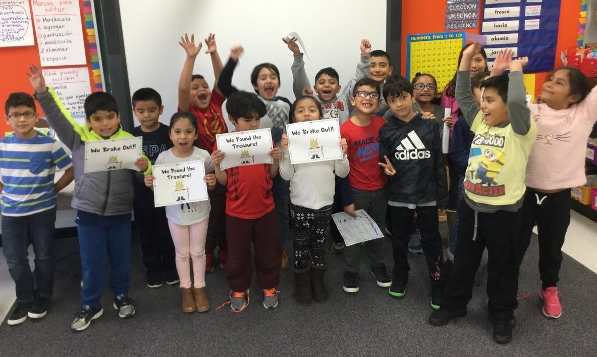 Students cheering that they completed a BreakoutEdu Activity