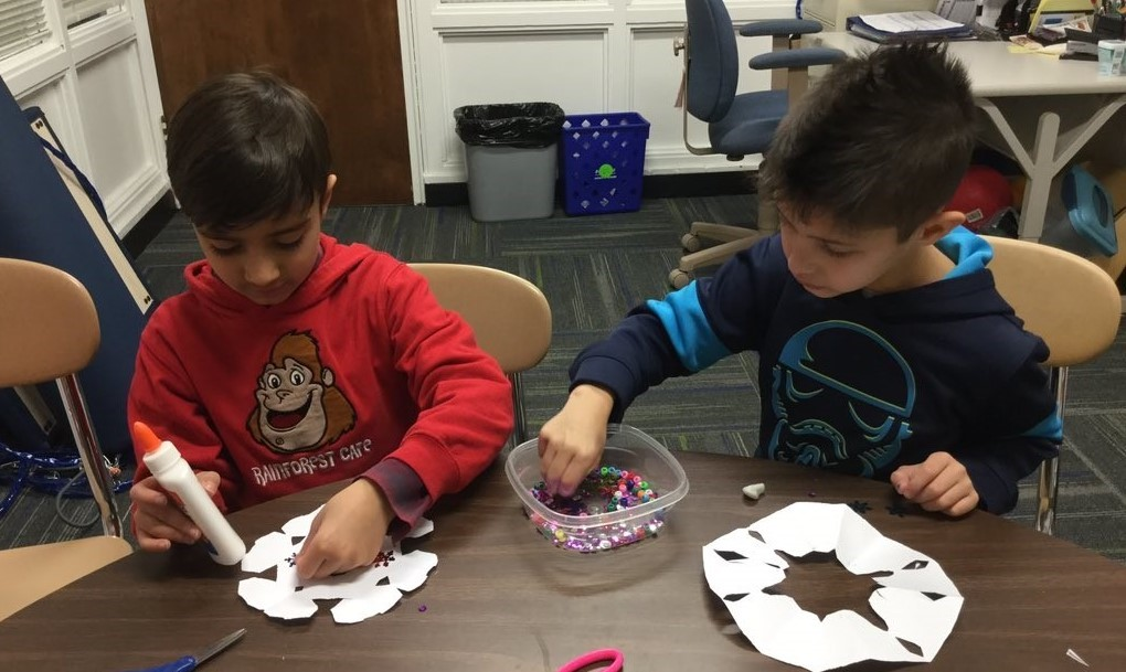 Student cutting and decoration snowflakes