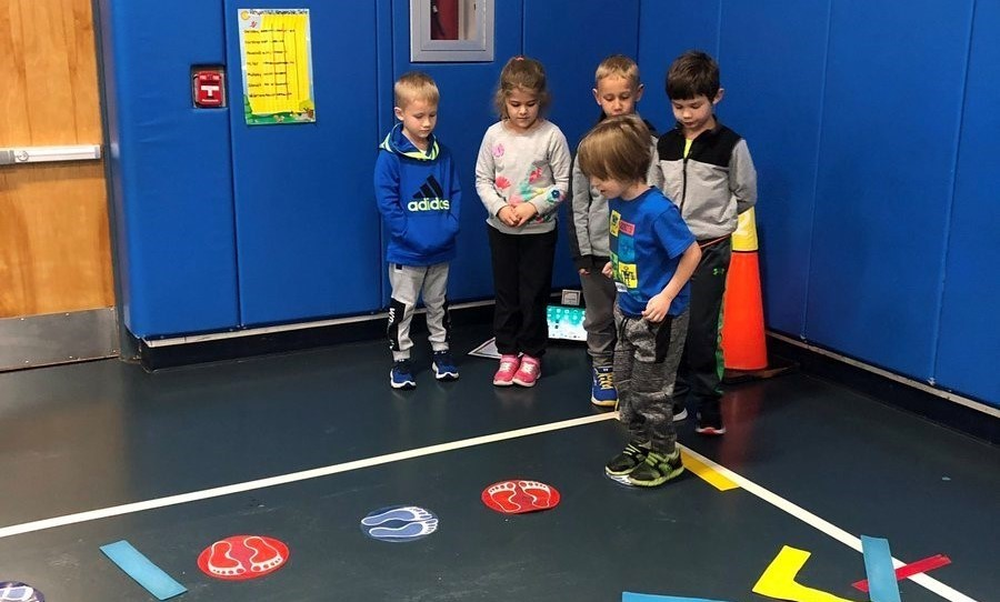 Students lined up in physical education for activity