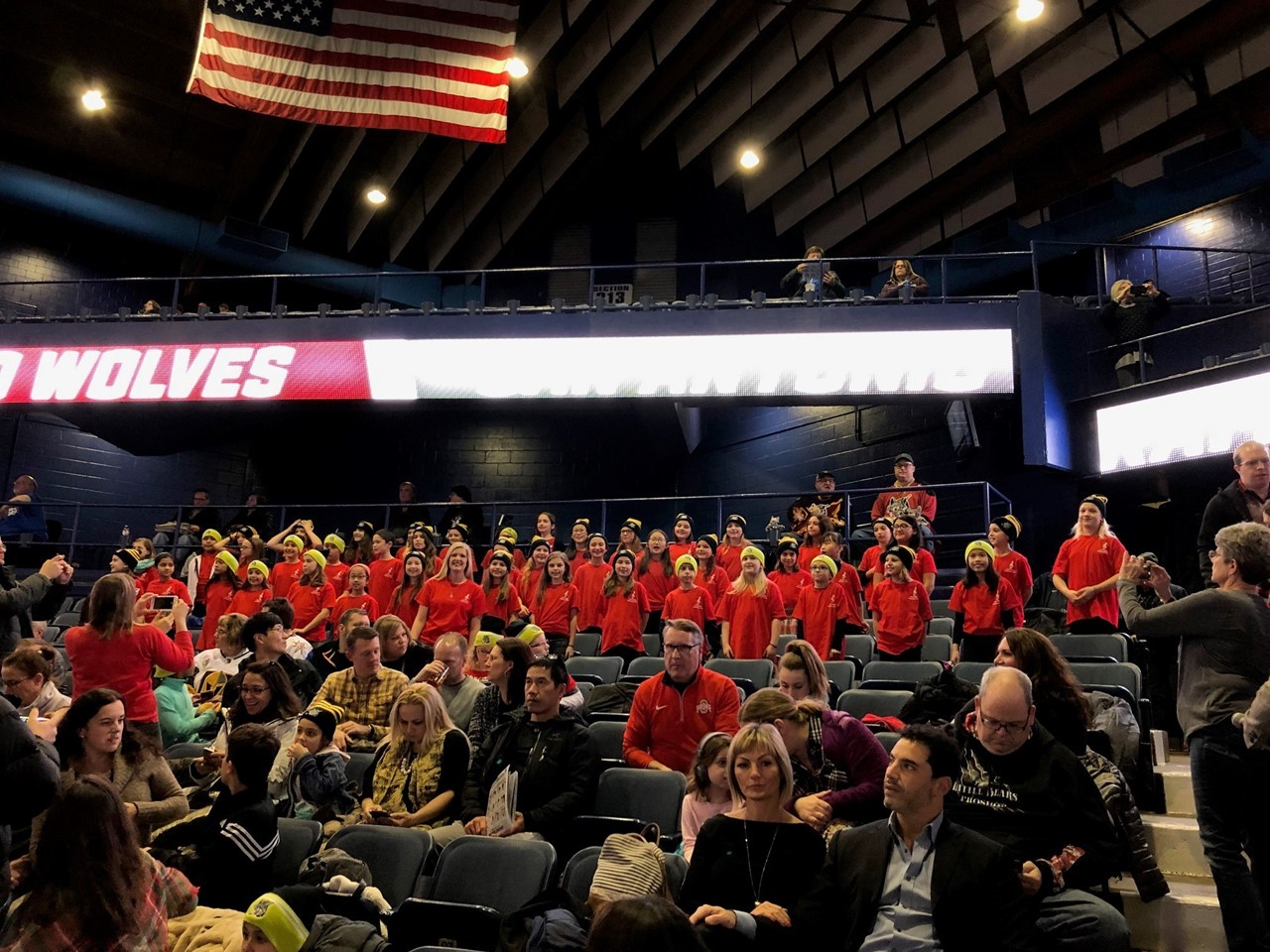 Students from Anne Sullivan choir at the hockey game.