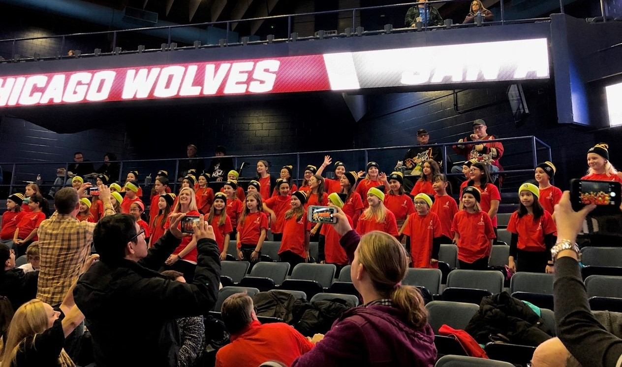 Students from Sullivan choir at the hockey game representing our school.