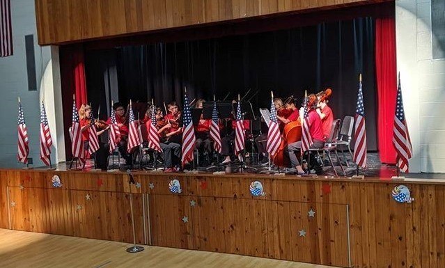 Orchestra students playing at the Veteran's Day Breakfast