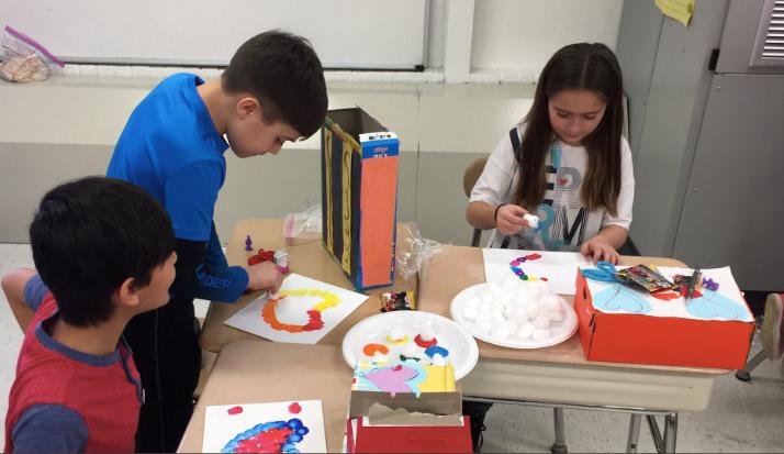 Children working on Valentine's Day crafts