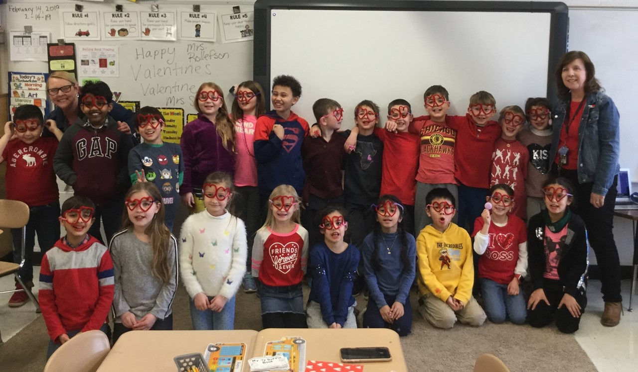 Second grade class with heart shaped glasses