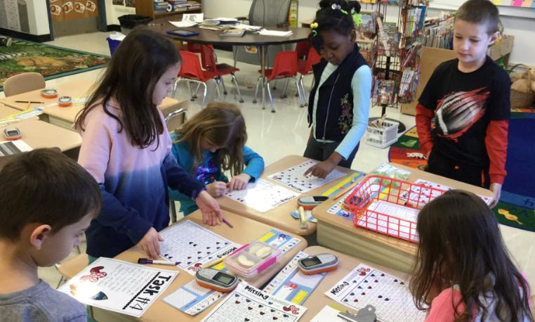 Ms. Gardiner's class working on a Valentine's Day Breakout EDU