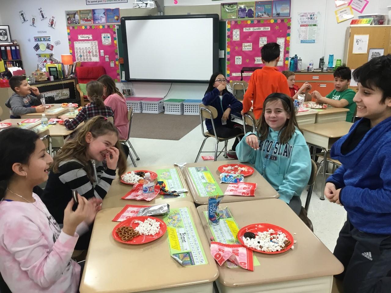 Students in Mrs. MacTavish's room enjoying Valentine's Day celebrations.