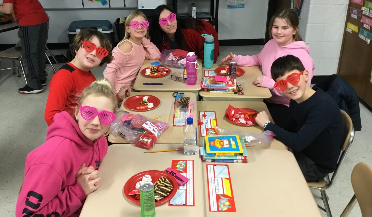 Mrs. Delgado and her students sharing their awesome heart shaped sunglasses during the Valentine's Day celebrations.