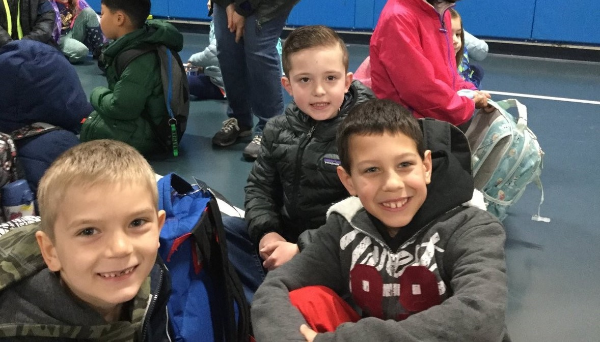 boys smiling while in line