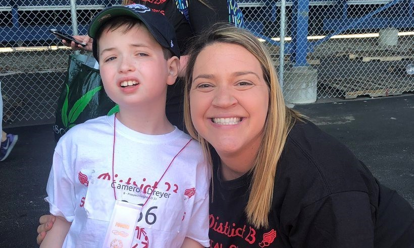 Smiling student with teacher at the Special Olympics