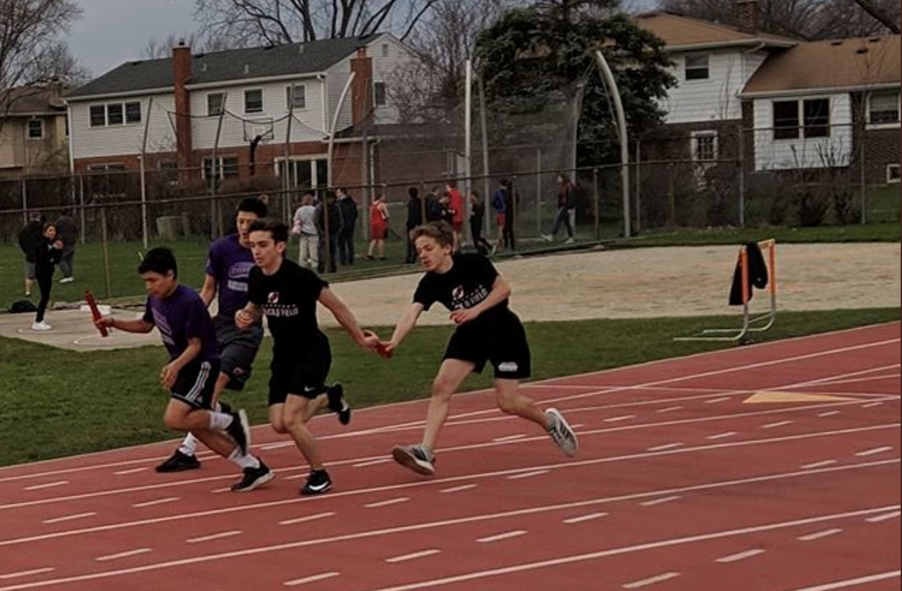 Boys running in track and field