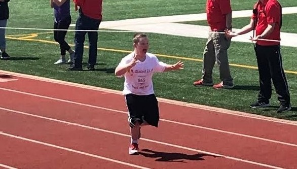 Student running on track