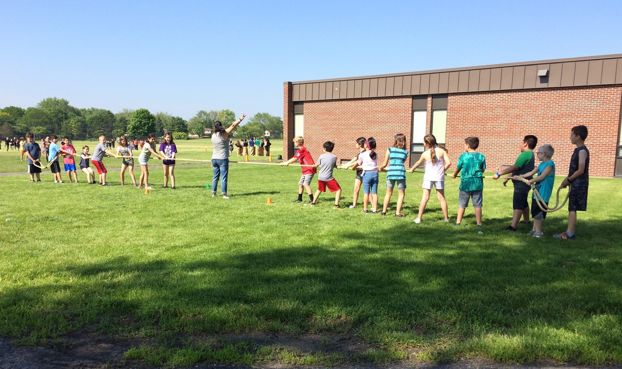 Field Day activity with students playing tug of war.