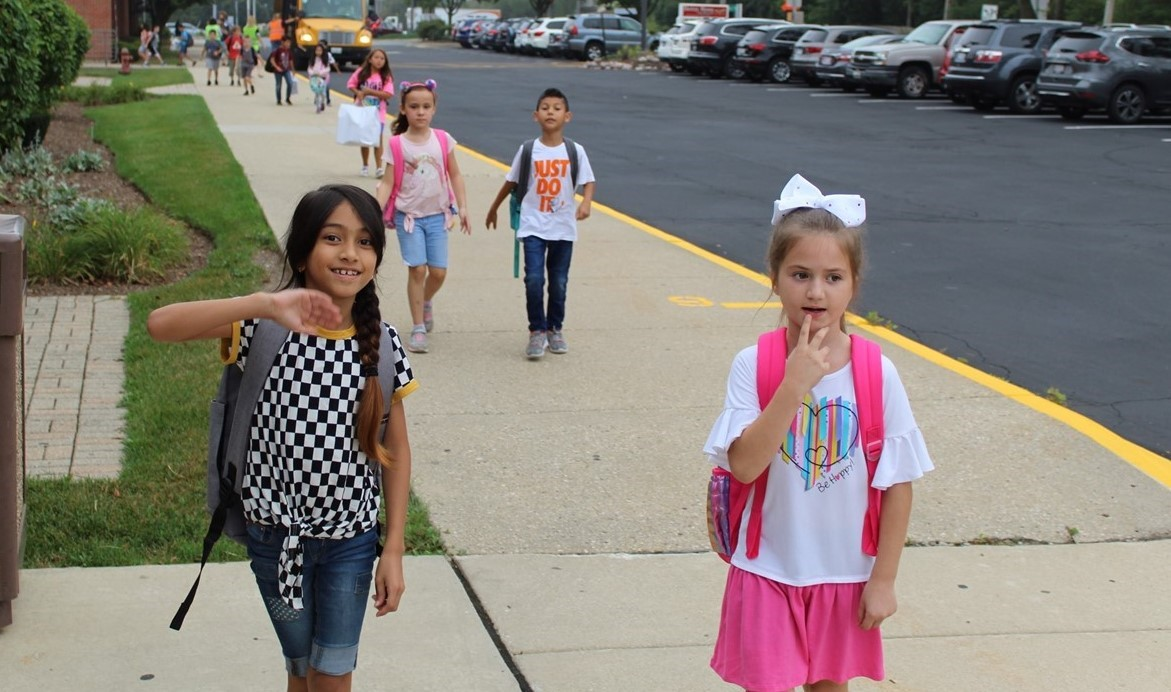Kids walking to school on the first day.