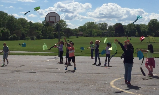 Students flying kites at Steam Club
