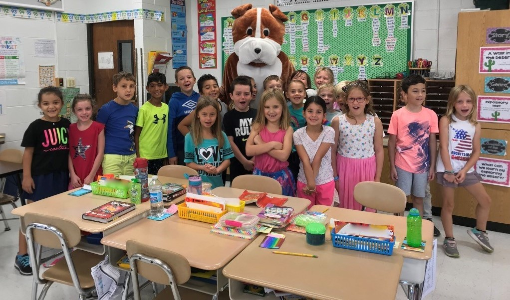 Students in the class taking a picture with the Bulldog mascot.