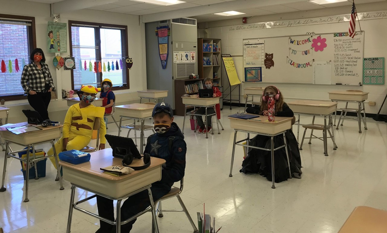 3rd graders in class wearing Halloween costumes.