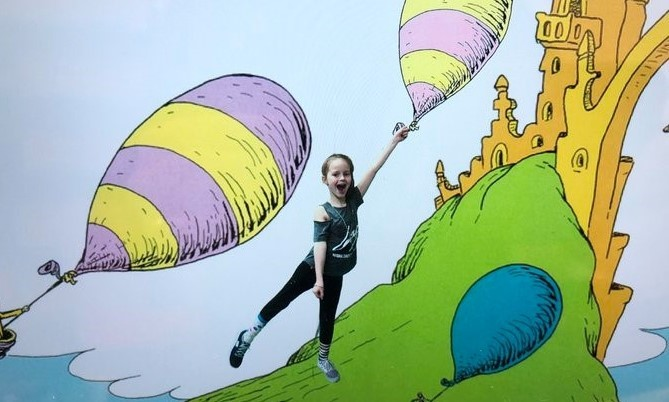 A student photoshopped to be part of a Dr. Seuss book.