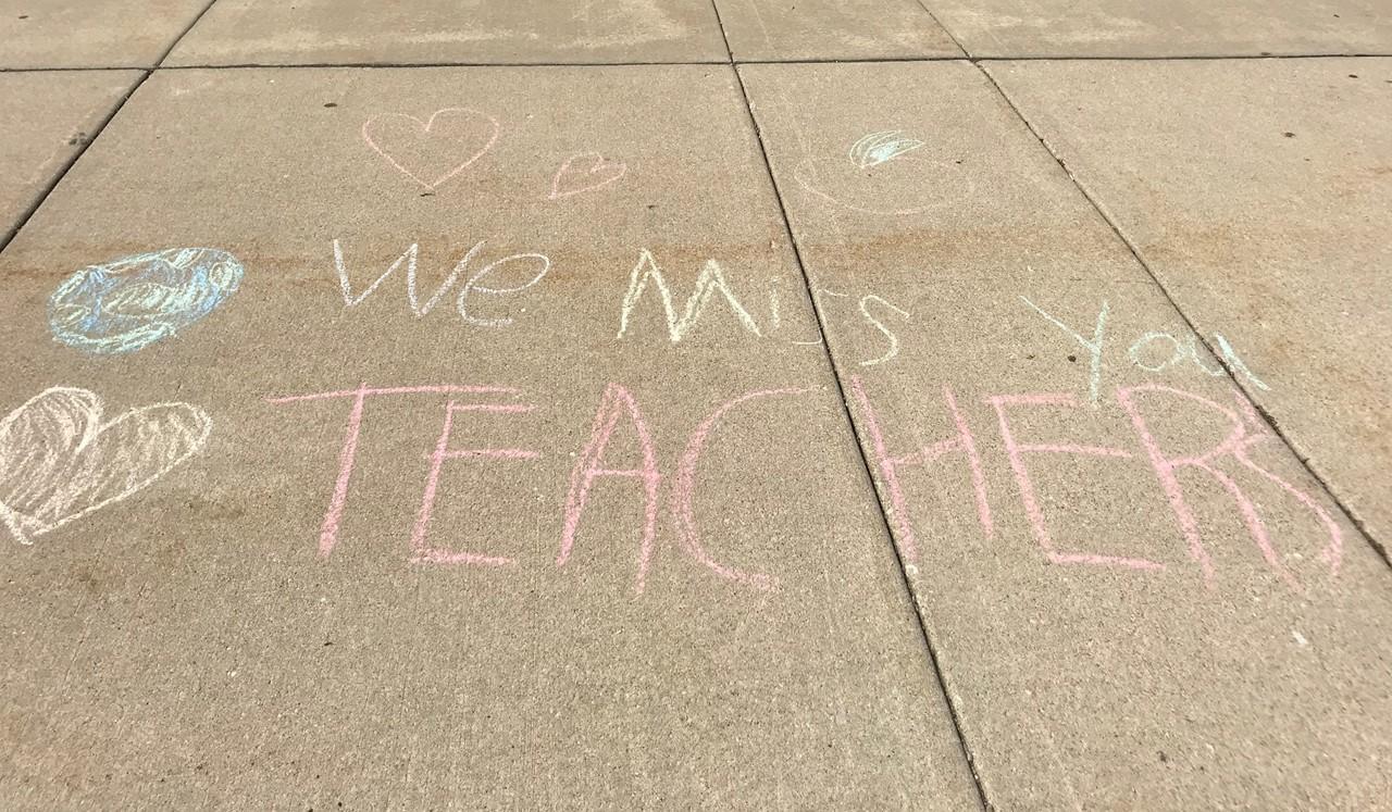 Chalk message to teachers.