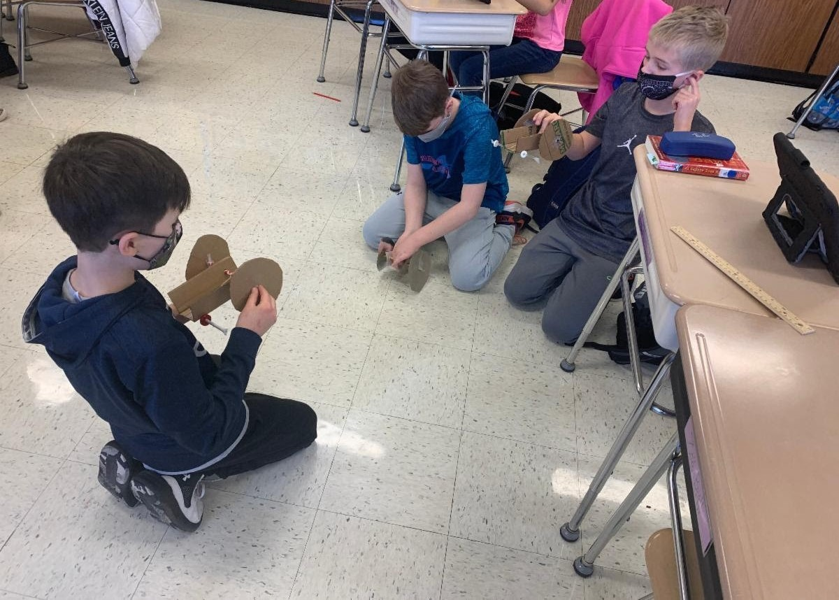 Students in Mrs. Travis' class created Mars Rovers as a STEAM activity in science class. Students used cardboard, rubber bands, scissors, straws, and candies to create rovers that move. 5th graders are learning about space and the Mars mission.