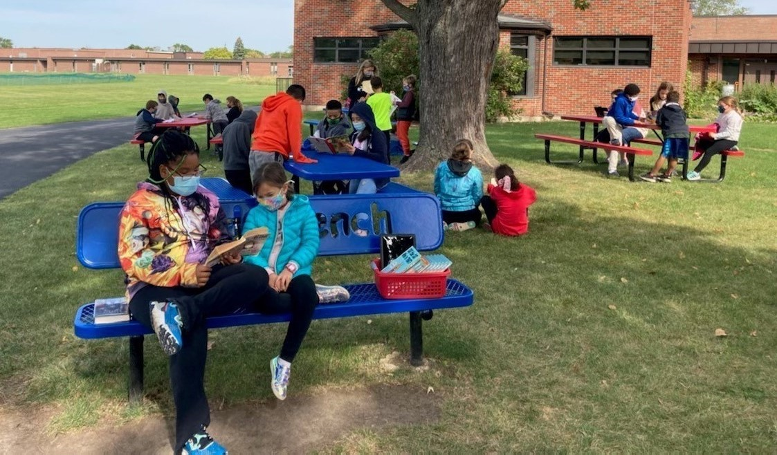 Students from Ross & Sullivan reading outside together