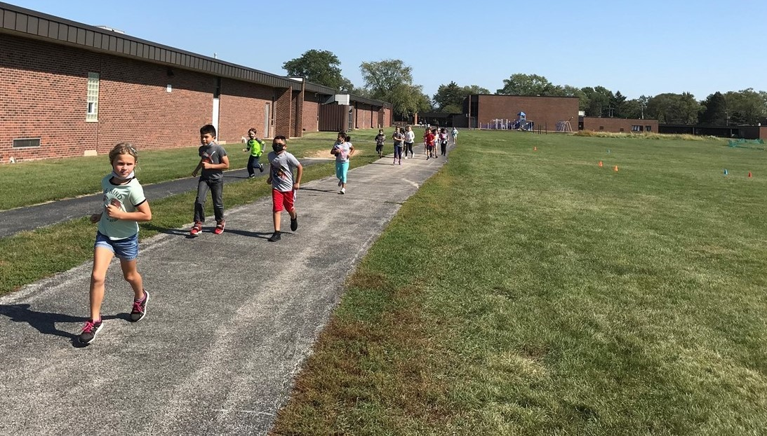 Students running at gym class